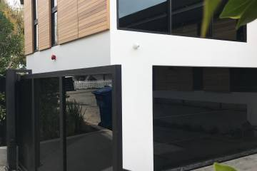 Luxury Brentwood Residential, tempered black glass drivway gate and Garage door