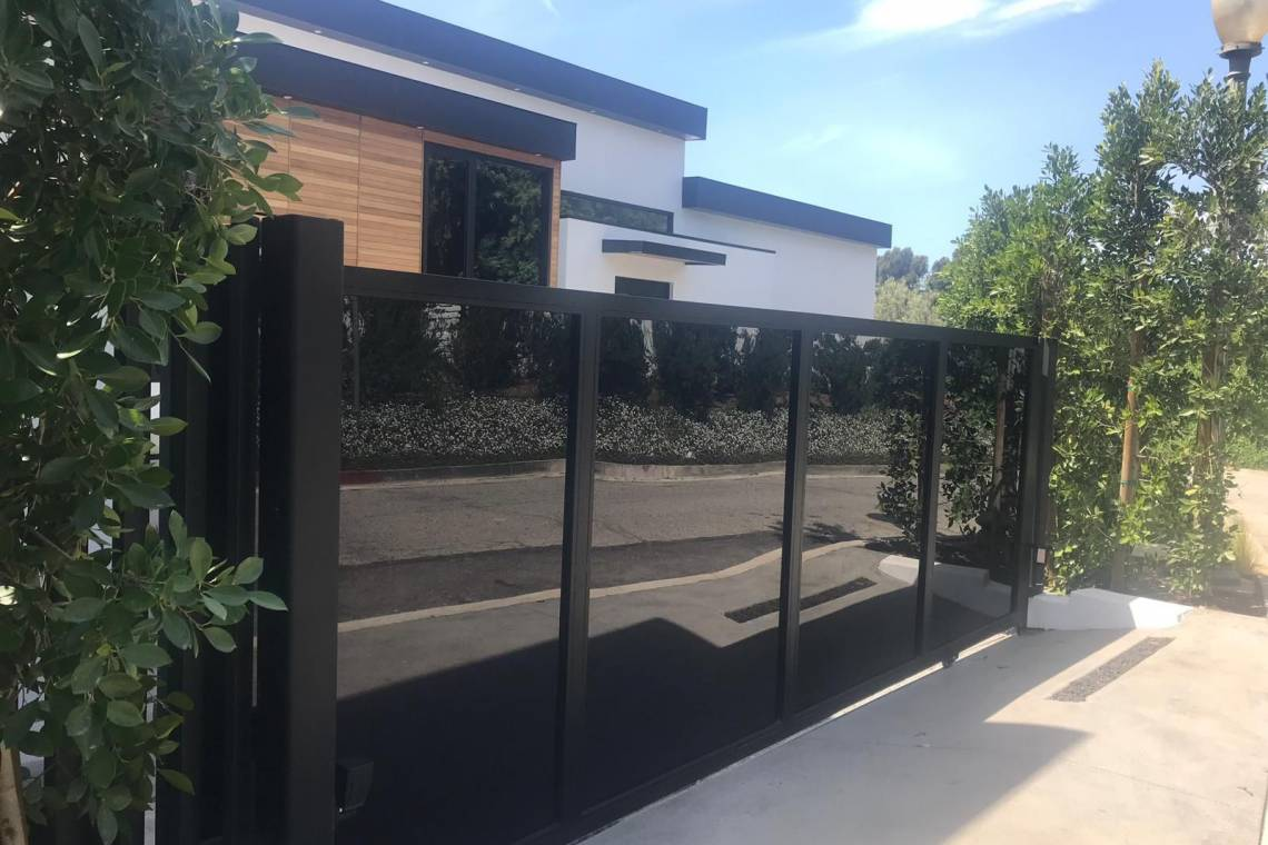 Fabrication and installation custom swing gate glass and metal
